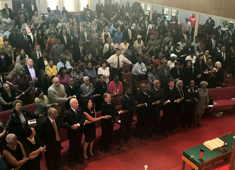 PHOTO:Presidential candidate and former Vice President Joe Biden, left front, joins the congregation of 16th Street Baptist Church in Birmingham, Alabama, as they sing We Shall Overcome€ at Sunday worship, Sept. 15, 2019.