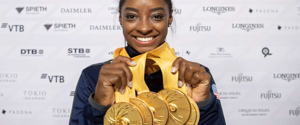 PHOTO: Simone Biles of the United States shows her five gold medals at the Gymnastics World Championships in Stuttgart, Germany, Oct. 13, 2019.