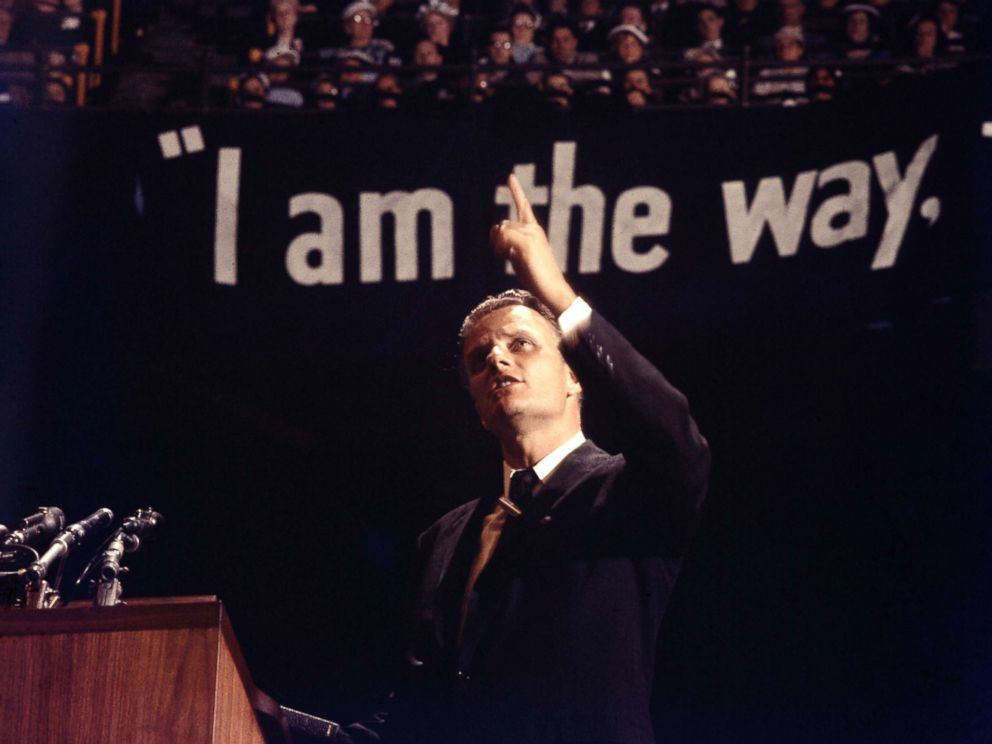 PHOTO: Evangelist Billy Graham preaches at Madison Square Garden in 1957. Known as Americas pastor, Graham was a key figure in the revival of the U.S. evangelical Christian movement and was an adviser to several U.S. presidents.