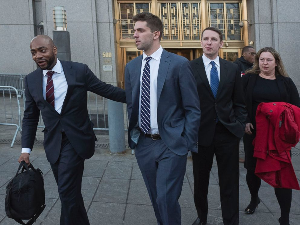 Billy McFarland, center, accompanied by his attorney Randall Jackson, left, leaves federal court after pleading guilty to wire fraud charges, Tuesday, March 6, 2018, in New York.