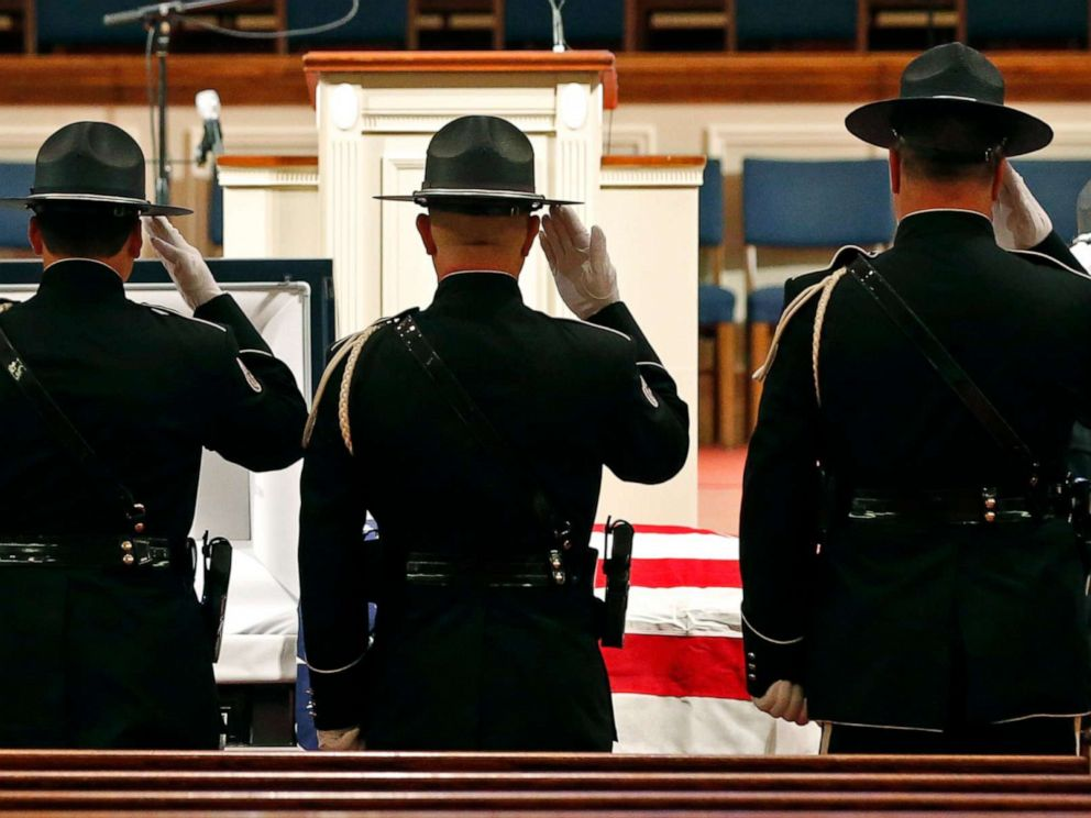 PHOTO:Members of the Biloxi Police Department Honor Guard salute the body of officer Robert McKeithen at the First Baptist Church of Biloxi, Miss., May 13, 2019.