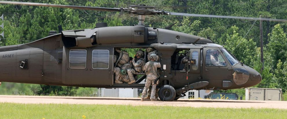 PHOTO: Soldiers with the 76th Infantry Brigade Combat Team, Indiana Army National Guard board a UH-60 Black Hawk helicopter at Joint Readiness Training Center, Fort Polk, Louisiana, July 23, 2017.