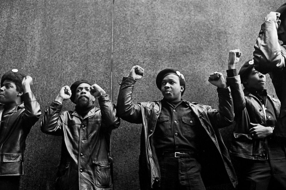 PHOTO: View of a line of Black Panther Party members as they demonstrate, fists raised outside the New York City courthouse, New York, April 11, 1969.
