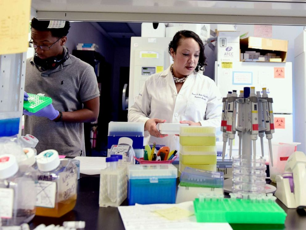 PHOTO: Dr. Luisel Ricks-Santi, Director of The Hampton University Cancer Research Center in Hampton, Va., prepares sample cancer cells to be tested in the lab on June 12, 2019.