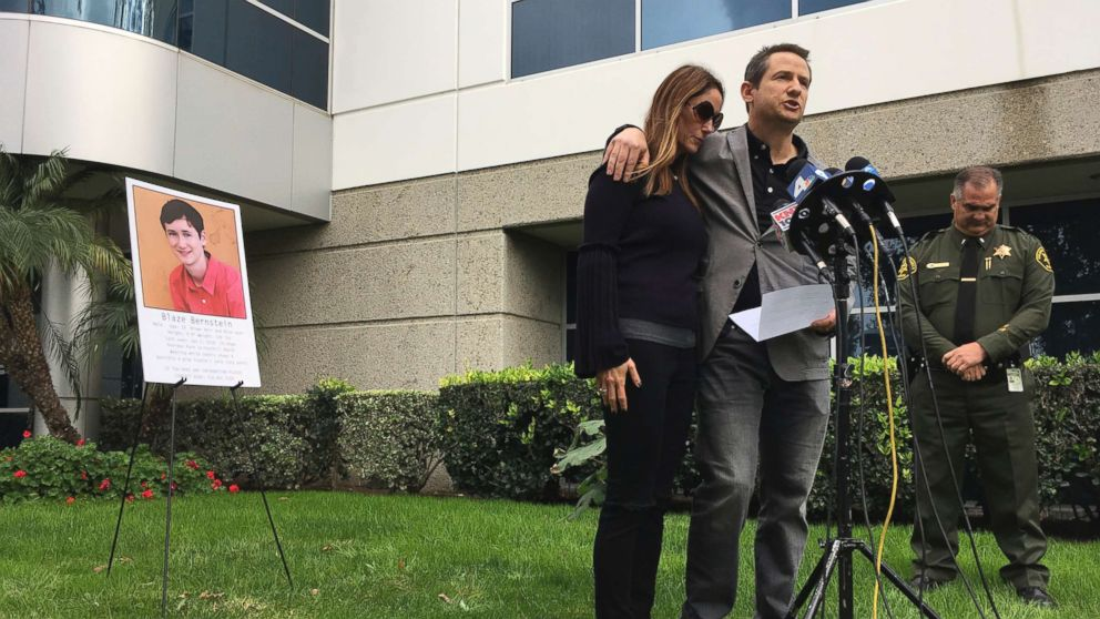 Gideon and Jeanne Bernstein, parents of missing teen Blaze Bernstein, are joined by Orange County Sheriff's Lt. Brad Valentine, right, during a news conference in Lake Forest, Calif. on Jan. 10, 2018. A suspect has been arrested in the death of 19-year-old University of Pennsylvania student Blaze Bernstein, whose body was found this week at a Southern California park.