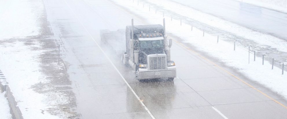 PHOTO: A truck travels east on Interstate 80 during a blizzard warning hitting southeast Wyoming and the Colorado Front Range on Wednesday, April 10, 2019, in Cheyenne.