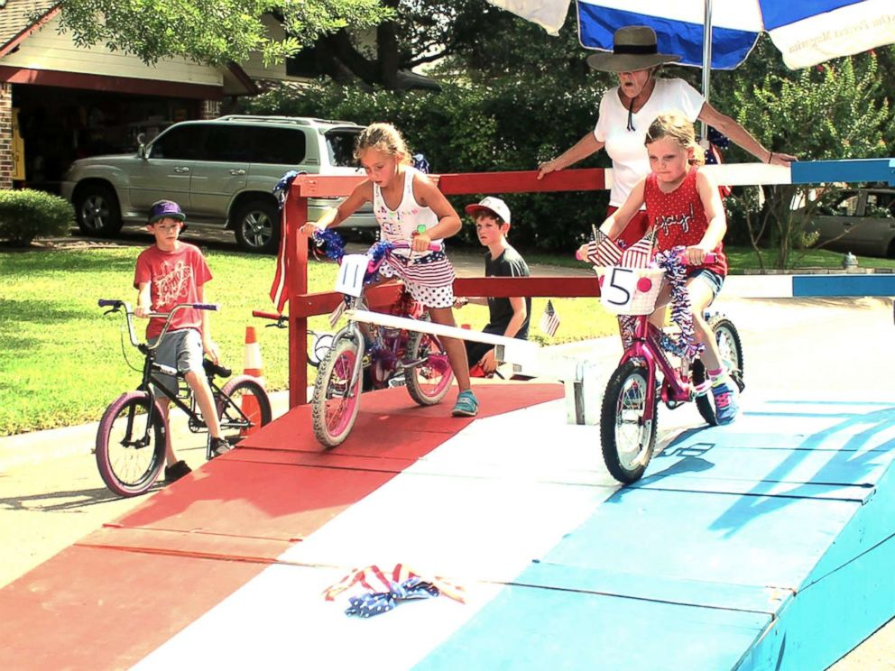 PHOTO: Residents of Riverton Drive in Austin, Texas, participate in a bike race during one of their annual block parties.