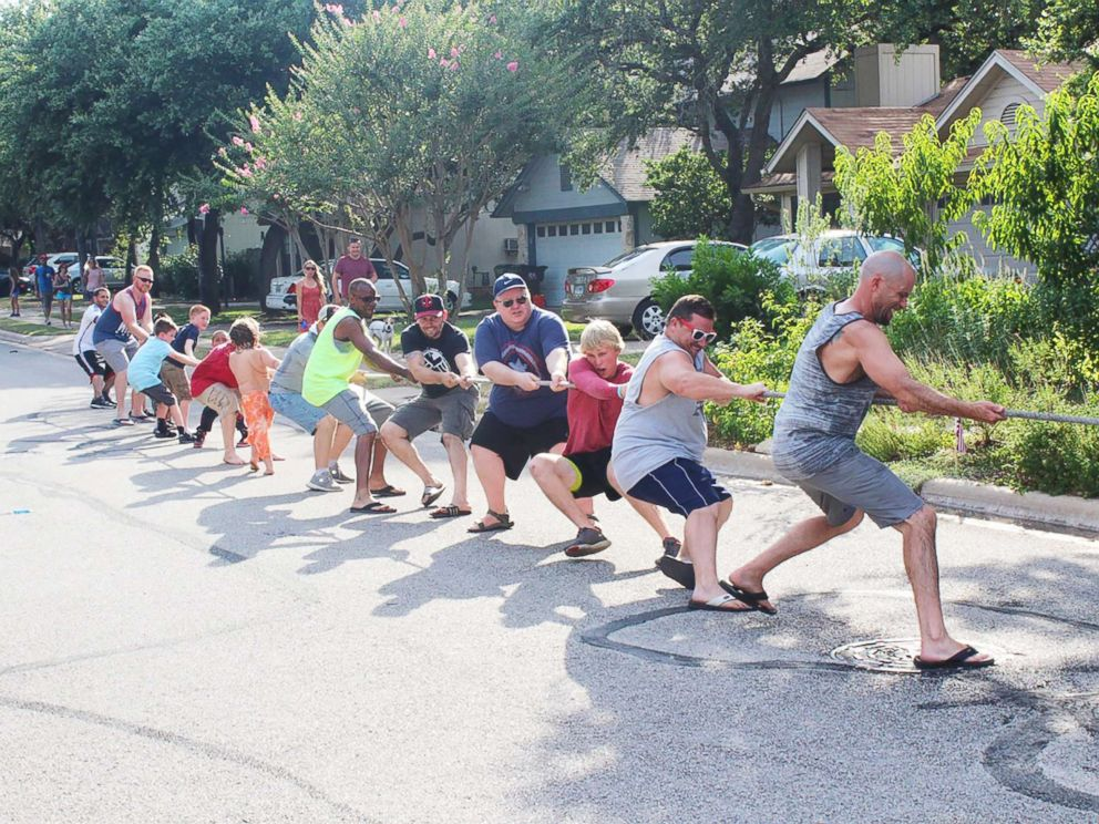 PHOTO: Residents of Riverton Drive in Austin, Texas, participate in a tug of war during one of their annual block parties.