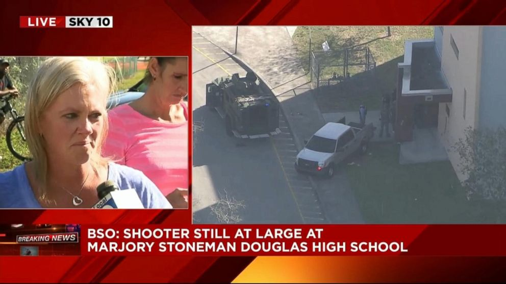 PHOTO: A woman said that her 9th-grade daughter was in the auditorium after reports of a shooting at Stoneman Douglas High School in Parkland, Fla., Feb. 14, 2018.