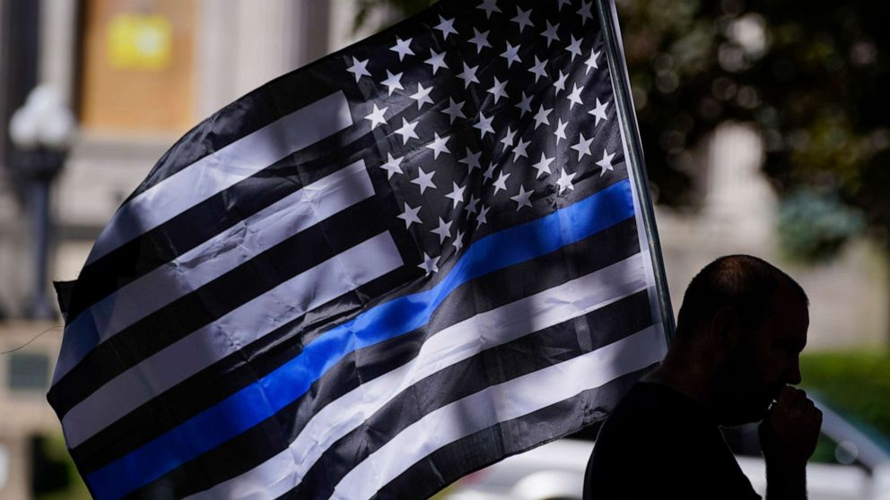 PHOTO: An unidentified man participates in a Blue Lives Matter rally Sunday, Aug. 30, 2020, in Kenosha, Wis.