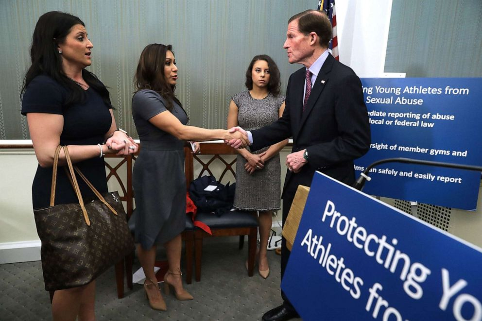 PHOTO: (L-R) 1996 Olympic Gold Medalist Dominique Moceanu, and former National Team members Jeanette Antolin and Mattie Larson are shown with Sen. Richard Blumenthal following a news conference, March 28, 2017, in Washington, D.C.