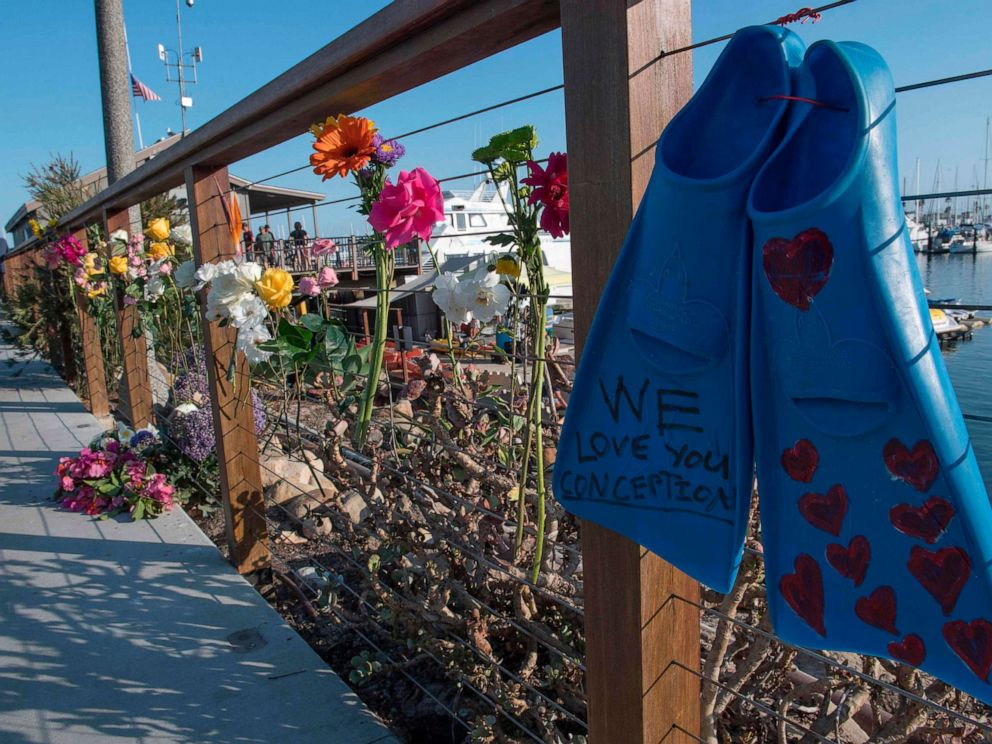 PHOTO: A pair of diving fins and flowers at a memorial wall near the Truth Aquatics moorings where the boat that burned and sank off the Santa Cruz islands, was based in Santa Barbara, Calif., on Sept. 2, 2019.