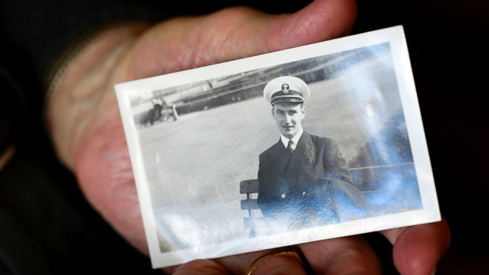 World War II veteran Bob Barger holds a photo of himself taken on Oct. 9, 1943, when he was serving in the U.S. Navy.