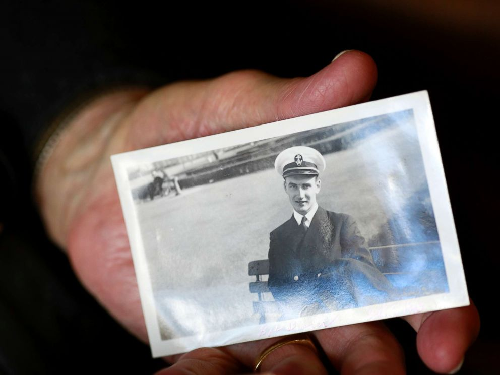 PHOTO: World War II veteran Bob Barger holds a photo of himself taken on Oct. 9, 1943, when he was serving in the U.S. Navy.
