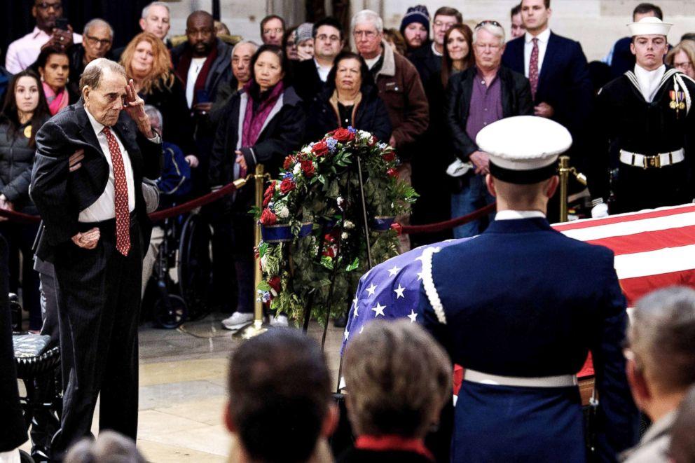 PHOTO: Former U.S. Senator Bob Dole salutes before the flag-draped coffin of former U.S. President George H. W. Bush at the U.S. Capitol rotunda in Washington, D.C., Dec. 4, 2018.