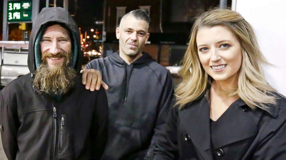 In this Nov. 17, 2017, file photo, Johnny Bobbitt Jr., left, Kate McClure, right, and McClure's boyfriend Mark D'Amico are pictured in Philadelphia.