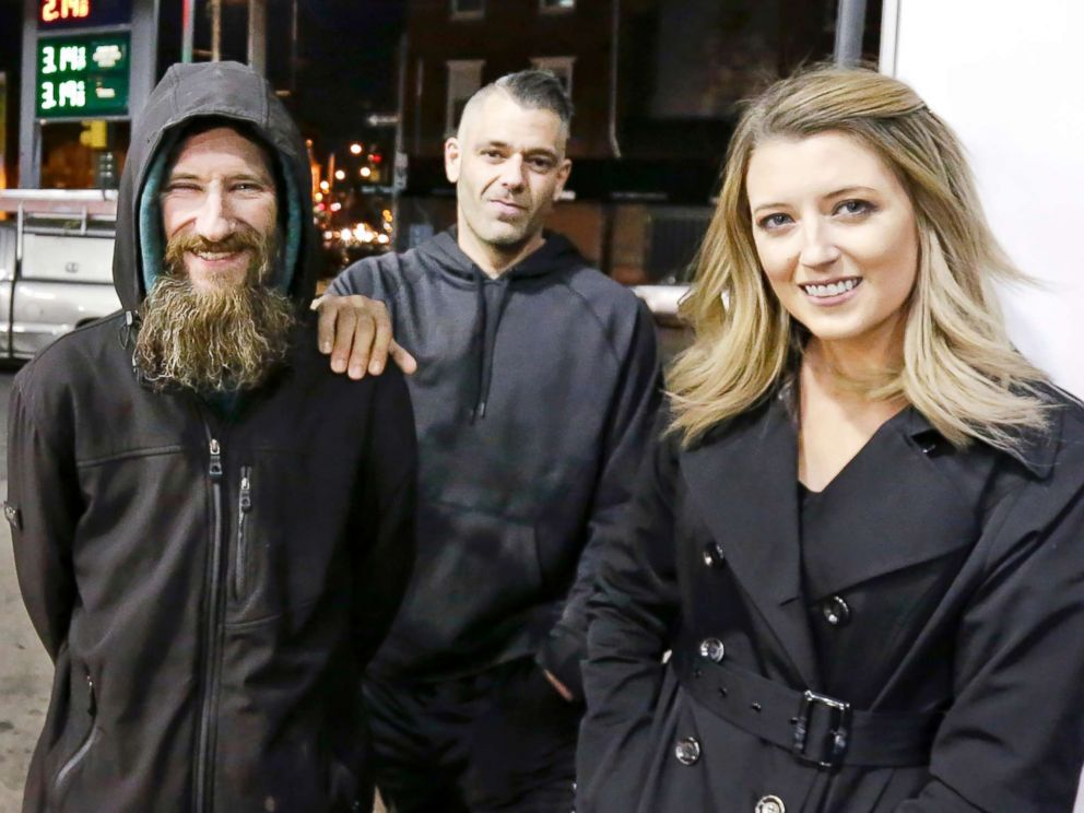PHOTO: In this Nov. 17, 2017, file photo, Johnny Bobbitt Jr., left, Kate McClure, right, and McClures boyfriend Mark DAmico are pictured in Philadelphia.