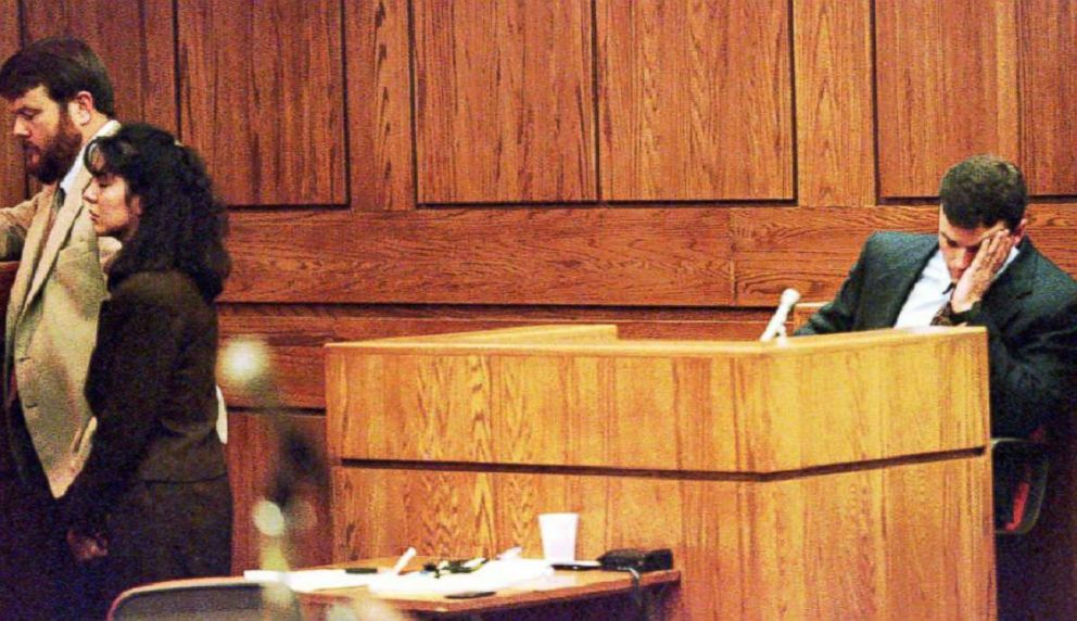 PHOTO: John Bobbitt waits while Lorena Bobbitt and her attorney talk with the judge during the second day of her trial, Jan. 11, 1994.
