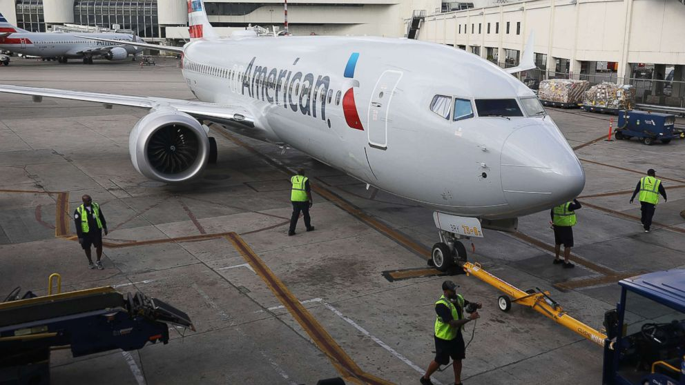 An American Airlines Boeing 737 Max 8 pulls into its gate after arriving at the Miami International Airport from Saint Thomas, March 13, 2019, in Miami. American Airlines is reported to say that it will ground its fleet of 24 Boeing 737 Max planes.