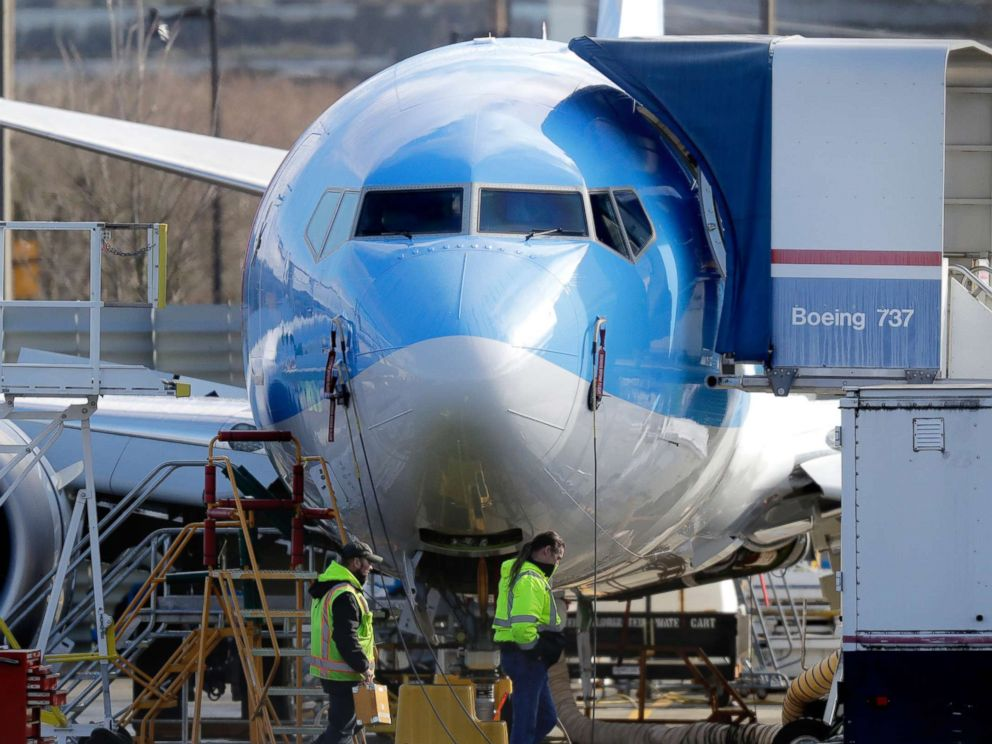 PHOTO: Workers walk past a Boeing 737 MAX 8 airplane being built at Boeing Co.s Renton Assembly Plant Wednesday, March 13, 2019, in Renton, Wash.