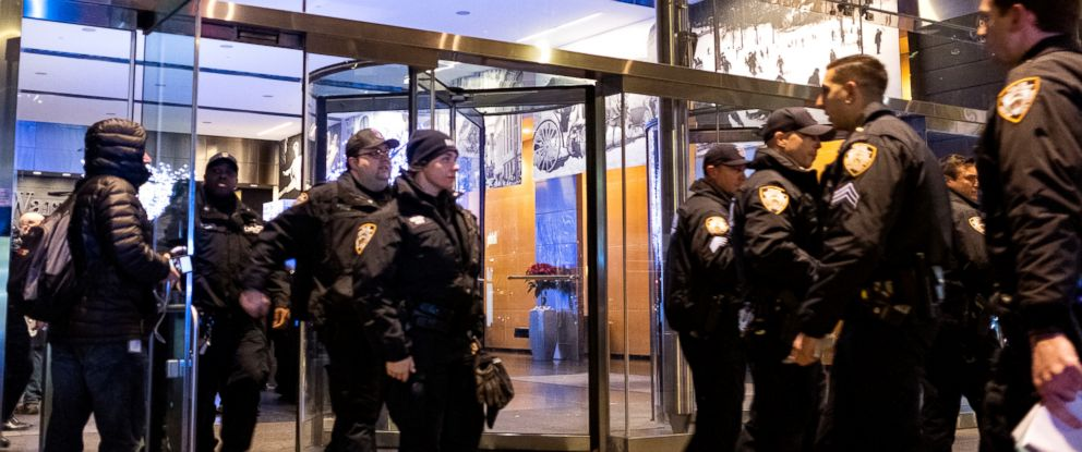 PHOTO: New York City police officers walk from the Time Warner Center in New York, Dec. 6, 2018, after a bomb threat was called into the building and occupants were evacuated.
