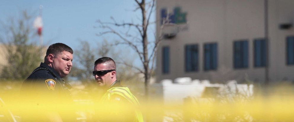 PHOTO: Police guard a road outside a FedEx facility following an explosion, March 20, 2018, in Schertz, Texas. A package exploded while being transported on a conveyor shortly after midnight this morning causing minor injuries to one person.