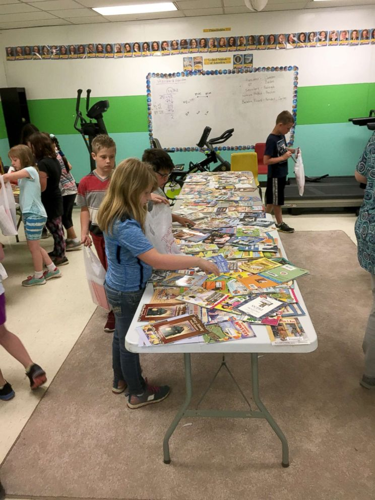 PHOTO: Students picking their books at Free Book Giveaway Day at South Polk Elementary School in May 2018.