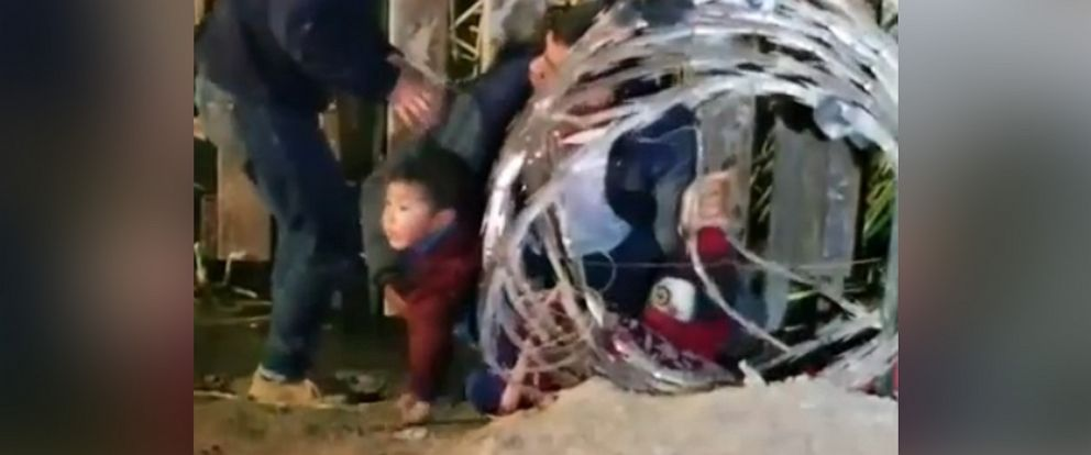 PHOTO: A still from video taken by U.S. Customs and Border Protection officers of people attempting to cross the Mexico-U.S. border at the Sanchez Canal near Yuma, Ariz.