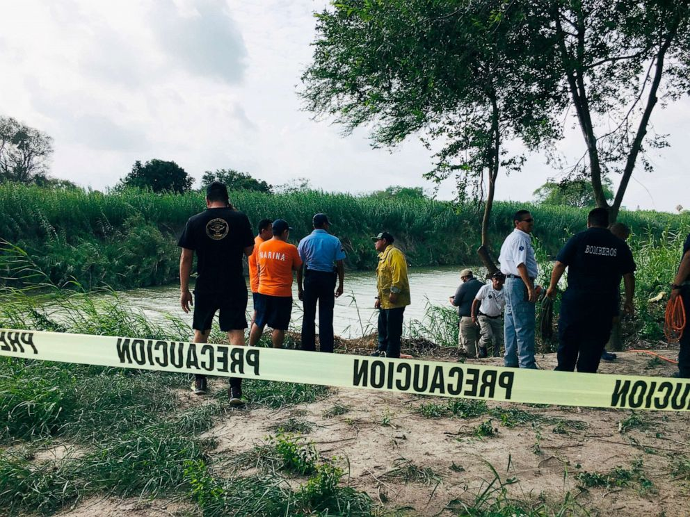 PHOTO: Authorities stand along the Rio Grande bank where the bodies were found, in Matamoros, Mexico, June 24, 2019, after they apparently drowned trying to cross the river to Brownsville, Texas.