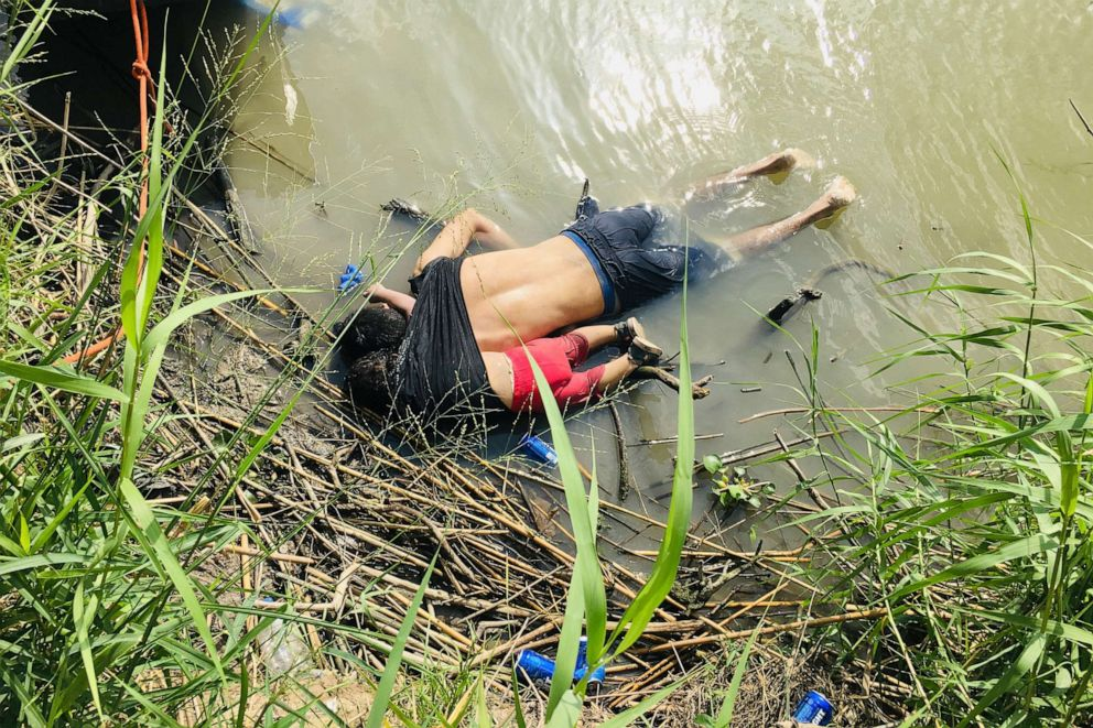 PHOTO: The bodies of a Salvadoran migrant and his daughter lie on the bank of the Rio Grande in Matamoros, Mexico, June 24, 2019, after they apparently drowned trying to cross the river to Brownsville, Texas.
