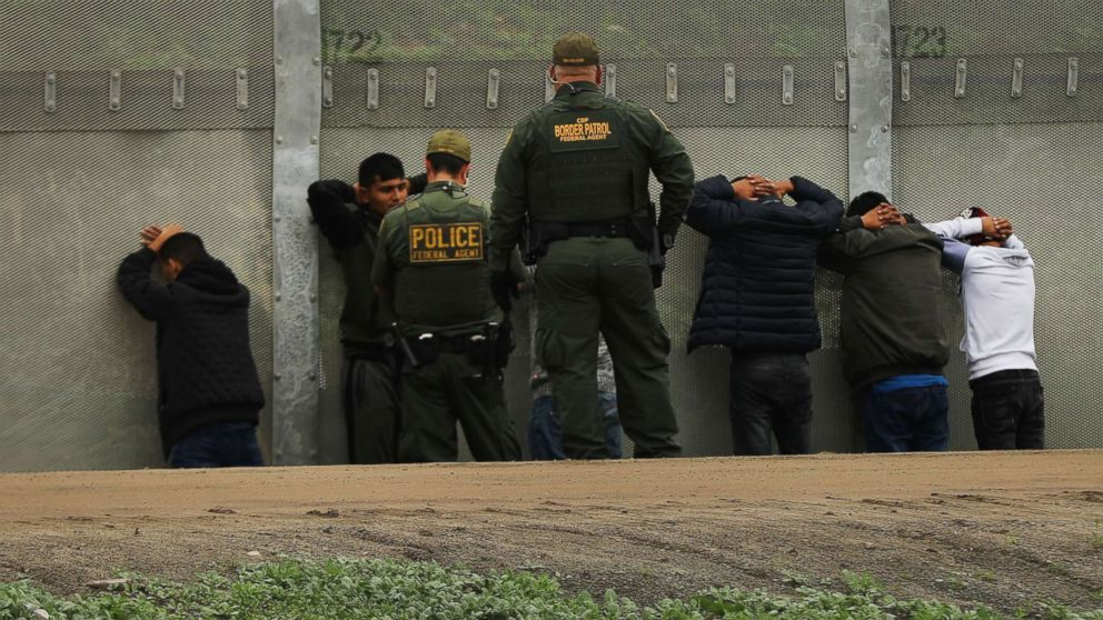 Men surrender to United States Border Patrol agents after jumping a fence in an attempt to get into America, Jan. 17, 2019, in Tijuana, Mexico. Tijuana has experienced a surge in Central Americans seeking to cross the border into America. The U.S. government is partially shut down as President Trump is asking for $5.7 billion to build additional walls along the U.S.-Mexico border.