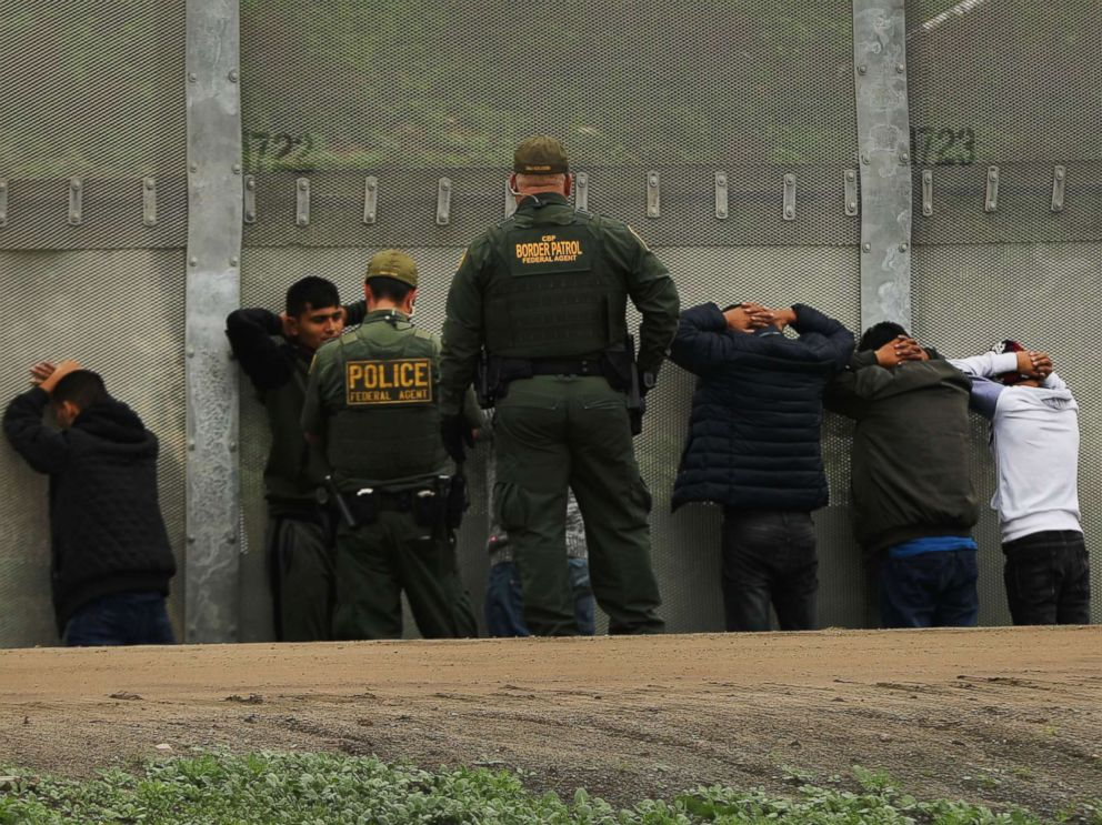 PHOTO: Men surrender to United States Border Patrol agents after jumping a fence in an attempt to get into America, Jan. 17, 2019, in Tijuana, Mexico.