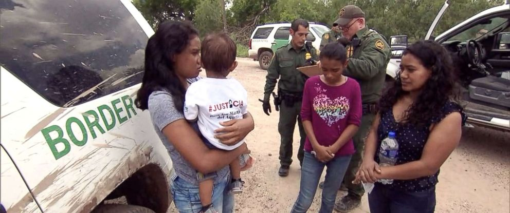 PHOTO: Border Patrol agents process two mothers caught shortly after being smuggled across the Rio Grande, one with a year-old child, the other with her 12-year-old daughter.