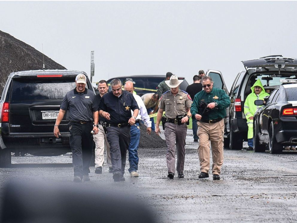 PHOTO: Law enforcement officers gather near the scene where the body of a woman was found near Interstate 35 north of Laredo, Texas, Sept. 15, 2018.