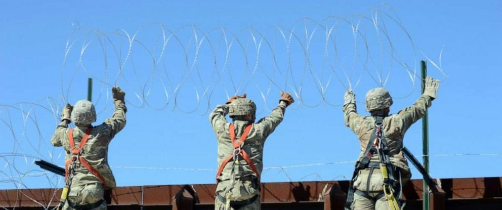 PHOTO: A team of Soldiers with 610th Engineer Support Company attach a string of concertina wire to the border fence at San Luis, Ariz., March 14, 2019.