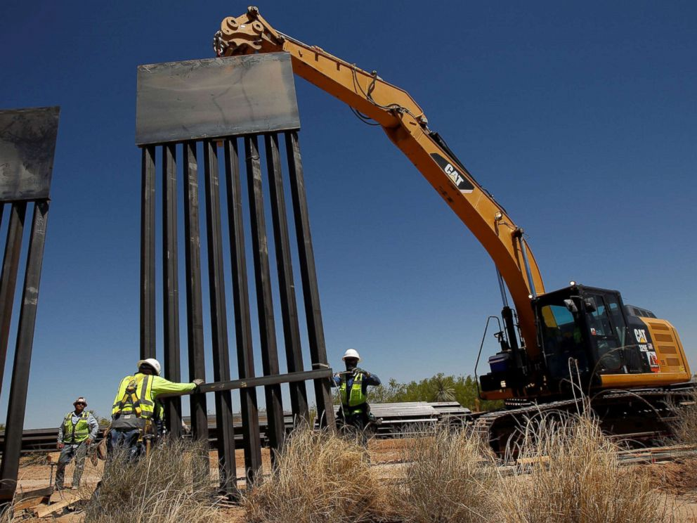 PHOTO: Construction workers place a panel of new bollard wall with the help of heavy machinery in Santa Teresa, New Mexico, as seen from the Mexican side of the border in San Jeronimo, on the outskirts of Ciudad Juarez, Mexico, April 23, 2018.
