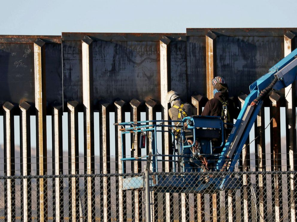 PHOTO: People work on the U.S./Mexican border wall, Feb. 12, 2019, in El Paso, Texas.