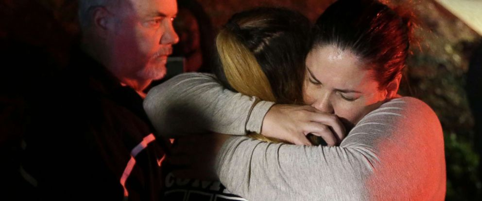 PHOTO: A woman who fled the Borderline Bar and Grill where a gunman killed 12 people is hugged by relatives in Thousand Oaks, Calif., Nov 8, 2018.