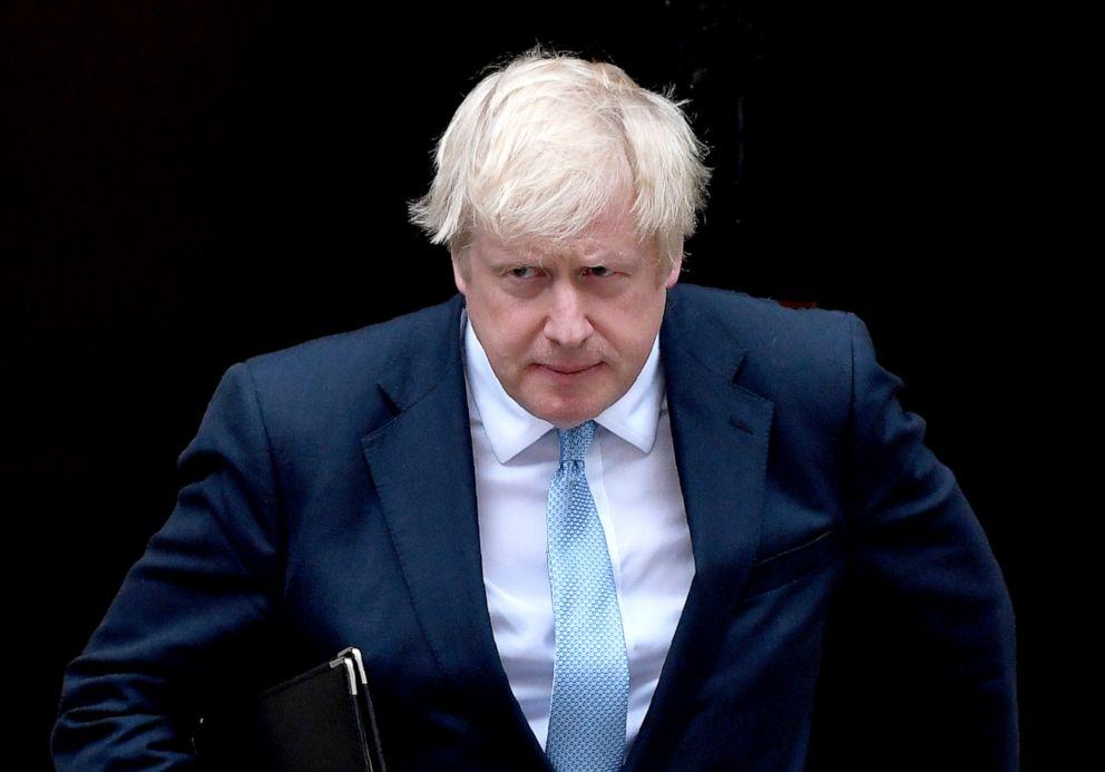 PHOTO: Britains Prime Minister Boris Johnson walks towards a podium to speak to the media outside 10 Downing Street in London, Sept. 2, 2019.