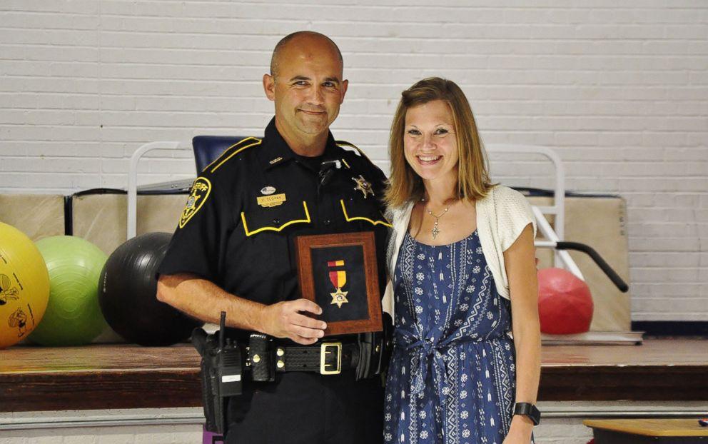PHOTO: Bossier Parish Sheriffs Deputy Chris Slopak receives the Star of Valor award for saving the life of the Plantation Park Elementary School teacher Lindsay Burns on Aug. 20, 2018.