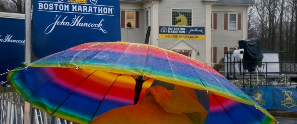 PHOTO: Cherry Scanzaroli, of Hopedale, Mass., holds a rainbow umbrella as she waits to cheer on runners at the start of the 122nd running of the Boston Marathon in Hopkinton, Mass., April 16, 2018.