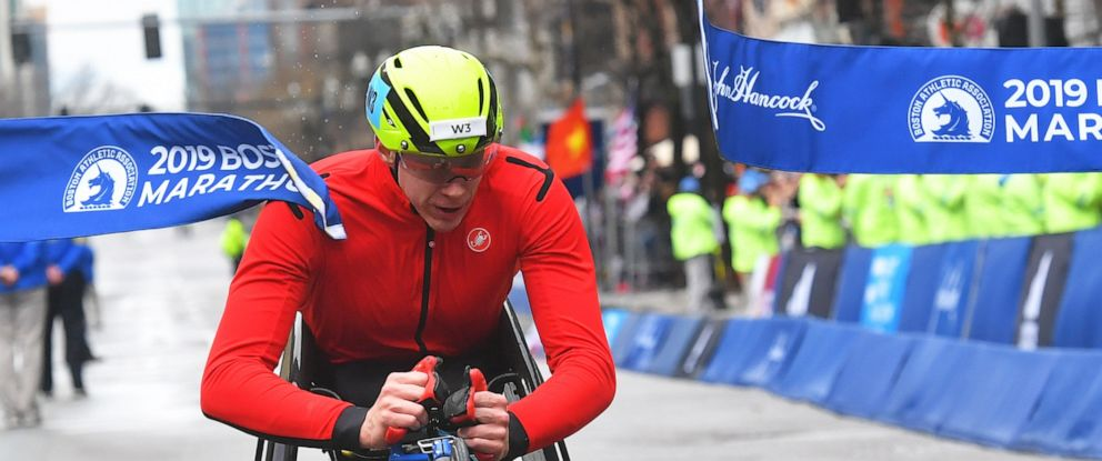 PHOTO: Daniel Romanchuk crosses the finish line first in the wheelchair division during the 123rd running of the Boston Marathon, April 15, 2019.