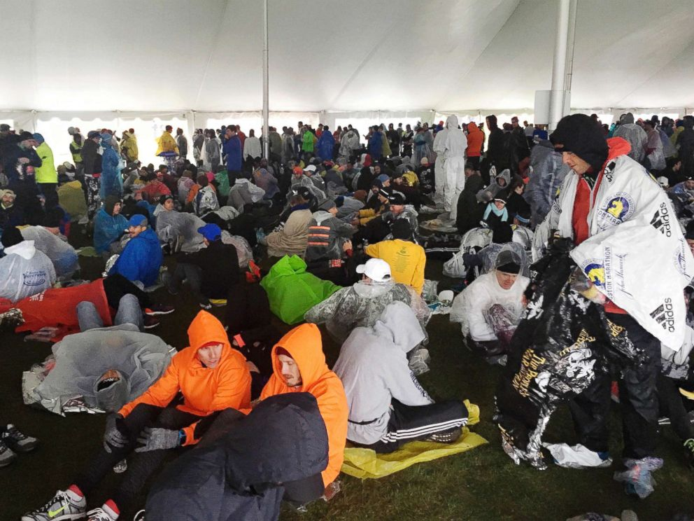 PHOTO: Runners wait under a tent at the athletes village for the start of the the 122nd Boston Marathon, April 16, 2018, in Hopkinton, Mass.