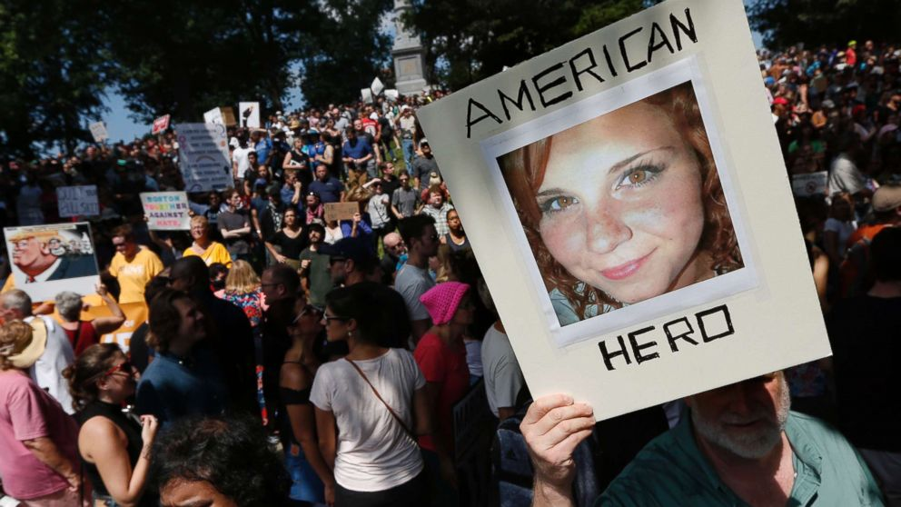 "A counterprotester holds a photo of Heather Heyer on Boston Common at a ""Free Speech"" rally organized by conservative activists, Aug. 19, 2017, in Boston. Heyer was killed last Saturday when a car, allegedly driven by James Alex Fields Jr., that plowed into a group of people during protests in Charlottesville, Va."