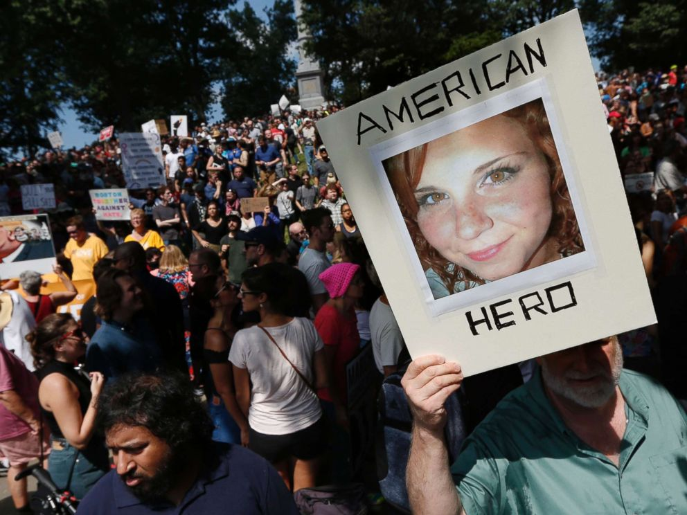 PHOTO: A counterprotester holds a photo of Heather Heyer on Boston Common at a Free Speech rally organized by conservative activists, Aug. 19, 2017, in Boston.