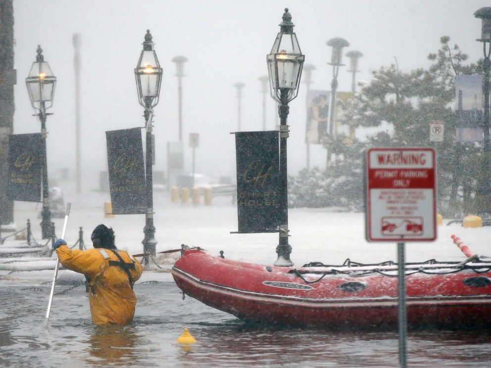 PHOTO: A firefighter wades through flood waters from Boston Harbor on Long Wharf in Boston, Jan. 4, 2018.