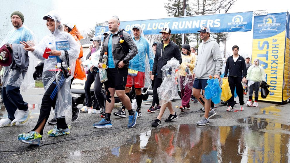 Runners prepare for the 2019 Boston Marathon in Boston, April 15, 2019.
