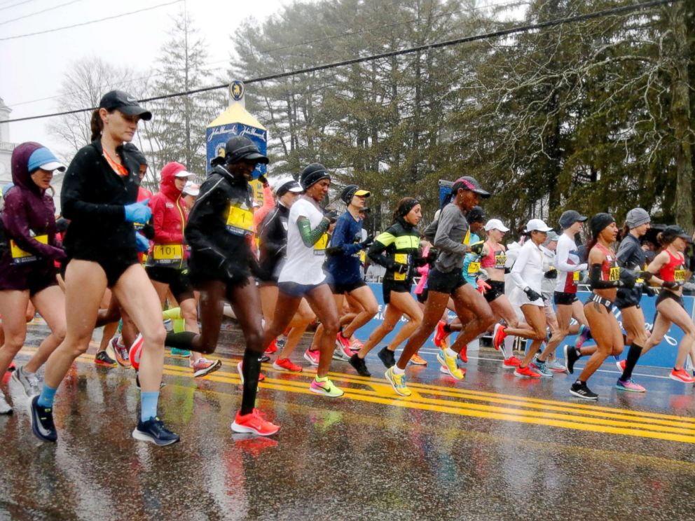 PHOTO: The elite female runners break from the starting line in a downpour during the 122nd running of the Boston Marathon in Hopkinton, Mass., April 16, 2018.