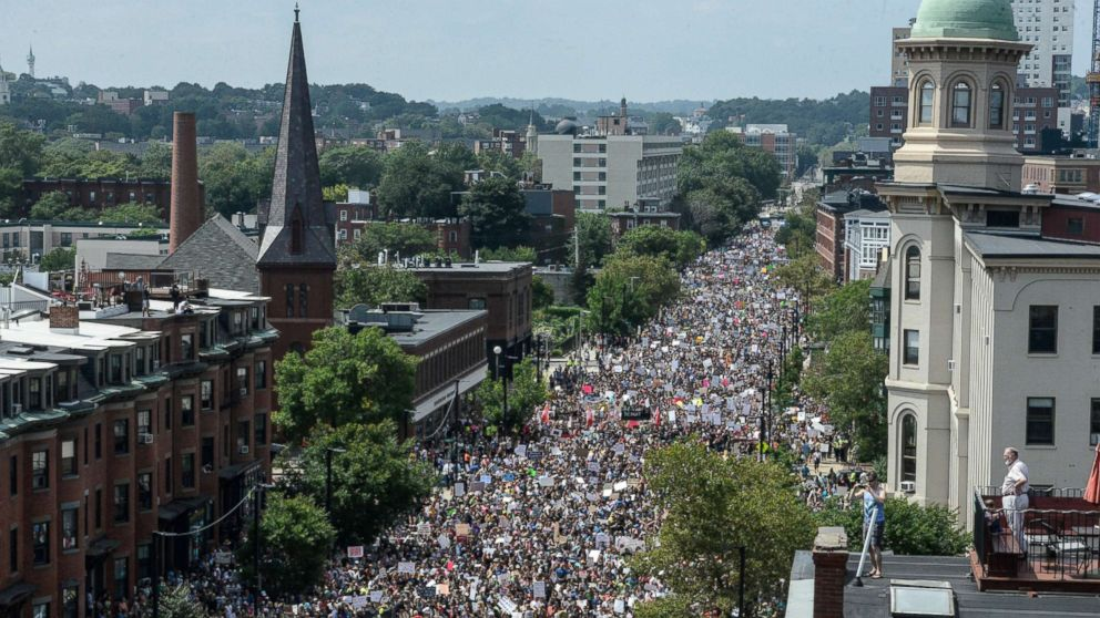 "A large crowd of people march towards the Boston Commons to protest the ""Free Speech Rally"" in Boston, Aug. 19, 2017."