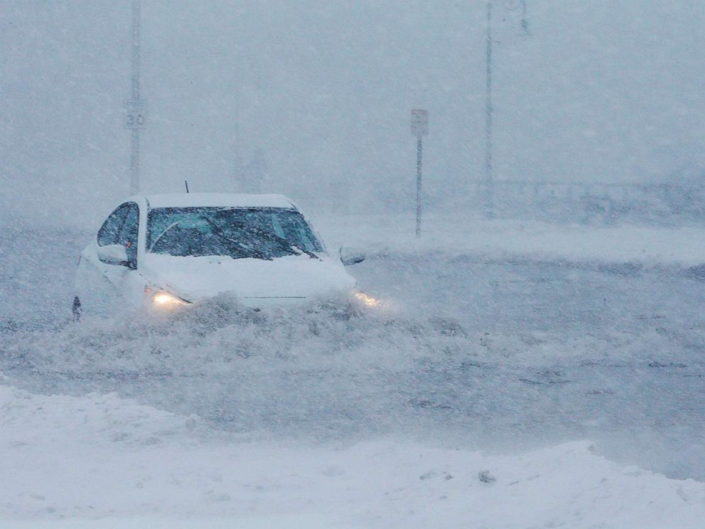 PHOTO: Drivers make their way along the flooded Beach Road after the ocean overtopped the seawall during a winter snowstorm in the Boston suburb of Lynn, Mass., Jan. 4, 2018.